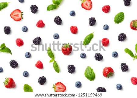 Fruit pattern of colorful berries and mint leaves isolated on white background. Top view. Flat lay #1251159469