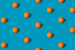 Fruit pattern of fresh orange slices on cyan blue background. Top view. Copy Space. art design, creative summer concept. citrus in minimal flat lay style. Banner, desktop, print, wallpaper.