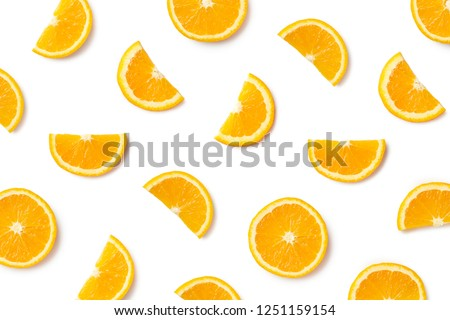 Fruit pattern of orange slices isolated on white background. Top view. Flat lay