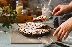 Fruit pie crust. Chef's hand cut with knife pie crust sliced on a rustic kitchen table.
