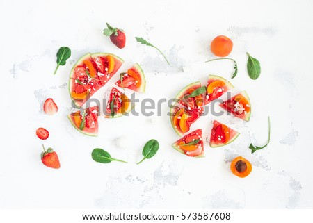 Fruit pizza made of watermelon, strawberry, apricot. Flat lay, top view. - Shutterstock ID 573587608