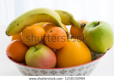 Fruit plate on the white background. Apples, bananas, oranges and mandarin.