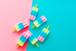 Fruit popsicle / ice cream stick on blue and pink background / Soda and Strawberry and Lemon popsicle / pastel color