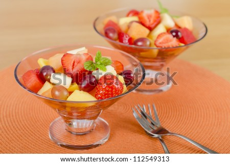 Fruit Salad - A colourful variety of fruit in glass bowls. Refreshing light meal!