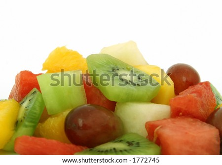 Fruit salad cocktail, macro close up isolated on white, with copy space