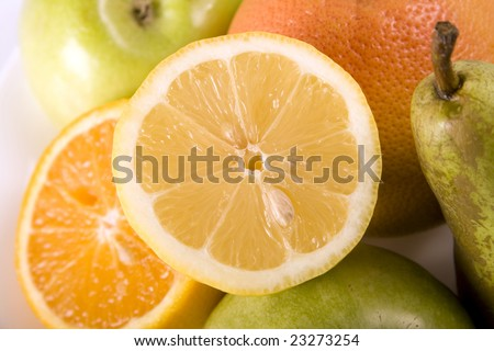 Fruit salad contains many different citrus fruits - stock photo