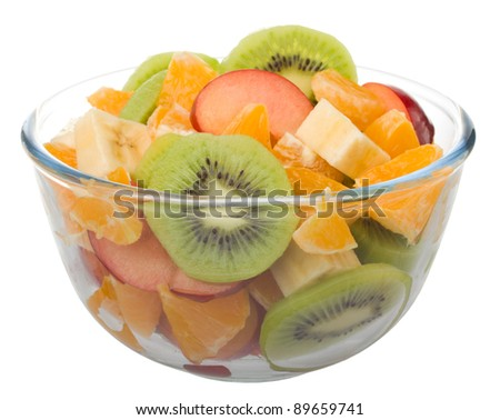 Fruit salad in glass bowl isolated on white background