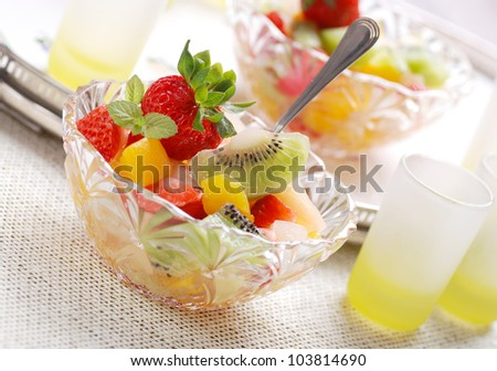 fruit salad in glass bowls on the tray