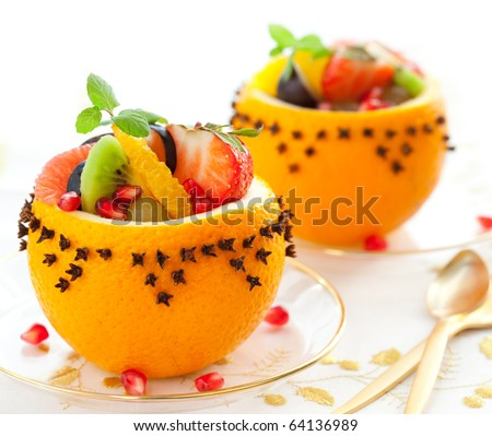 stock photo : Fruit salad in  hollowed-out oranges studded with cloves   for Christmas