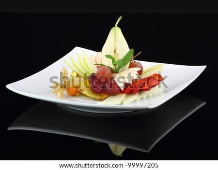 Fruit salad on black background
