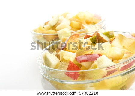 Fruit salad with apples, oranges, peaches, pears and orange juice ...