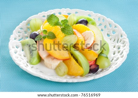 fruit salad with banana, orange, peach, grape, apple, orange, pear