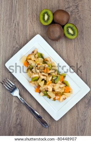 fruit salad with kiwi, orange, pineapple and banana