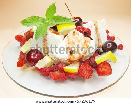 fruit salad with strawberry cherry lemon raspberry and pudding
