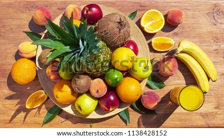 Fruit set from pineapple, oranges, lemons, peaches, coconut, nectarines, kiwi, bananas. Vitamins. Multifruit juice.