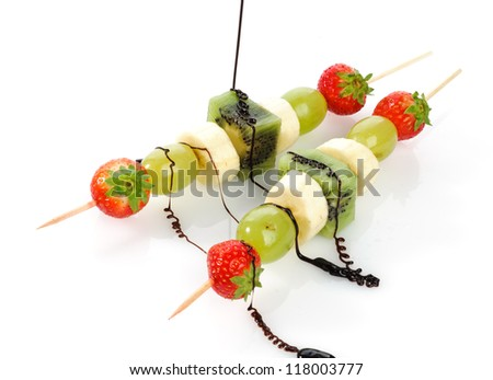 Fruit skewers and chocolate