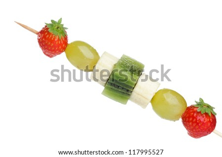 Fruit skewers on white background