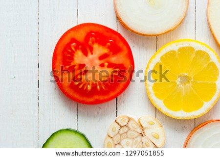 fruit slices variation on white wooden table background