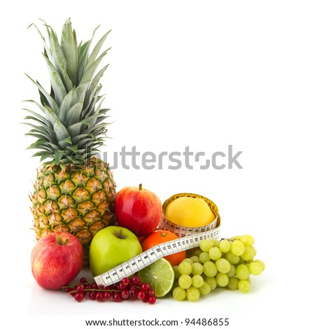 Fruit still life with pineapple apples oranges and measurement tape