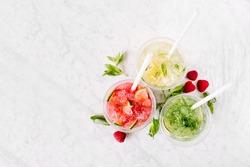 Fruit summer drinks with ice. Flat lay, top view.