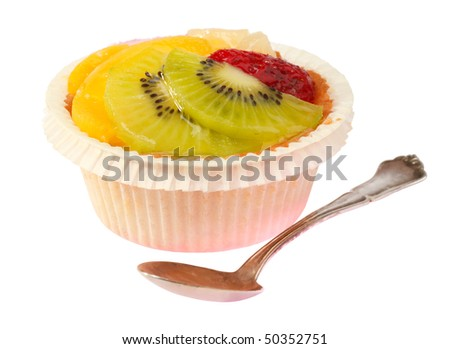 Fruit tart with Kiwi, strawberries and peach. Isolated on white background.