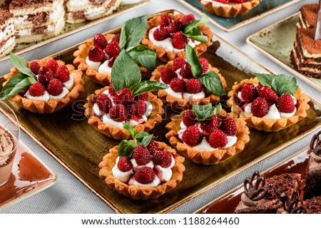 Fruit tart with raspberries and cream, cakes and sweetness on holiday background. Delicious dessert and candy bar