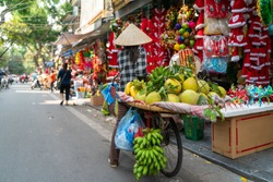 Fruit vendor on Hanoi old town street at early morning