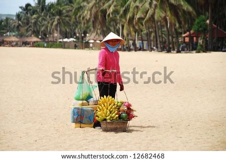 fruit vendor on Nhatrang beach, Vietnam