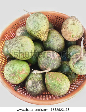 Fruit - Wood apple or bael. Scientific name - Aegle marmelos. The fruits can be eaten either fresh from trees or after being dried and produced into candy, toffee, pulp powder or nectar.