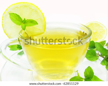 fruit yellow herbal tea with lemon and mint