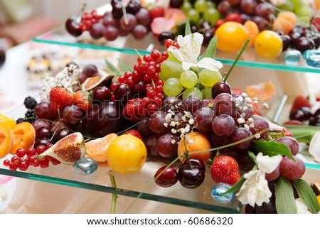 Fruits and flowers on banquet table, catering
