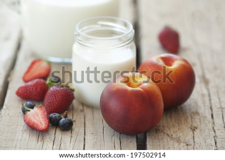 Fruits and milk on wooden background