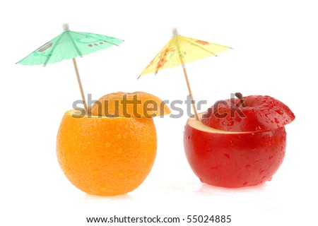 Fruits and umbrellas on a white background
