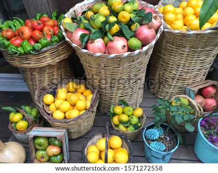 fruits and vegetables conceptual buying photo shoot at the grocery store contrasting fruit composition shooting different alternative compositions in wood and wicker.  #1571272558