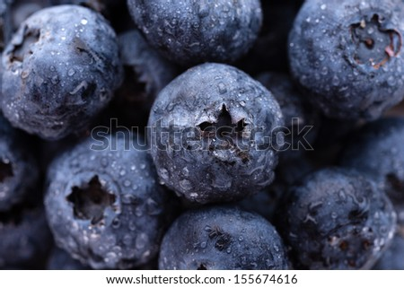 Fruits and vegetables: group of fresh wet blueberries, close-up shot #155674616