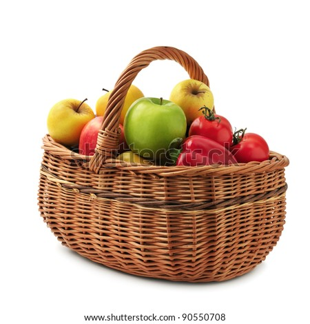 fruits and vegetables in basket isolated on a white background