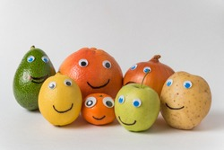 fruits and vegetables in form of characters with funny faces. Big happy family concept.