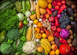 Fruits and vegetables large overhead assortment on colorful background in studio green, white, yellow to red