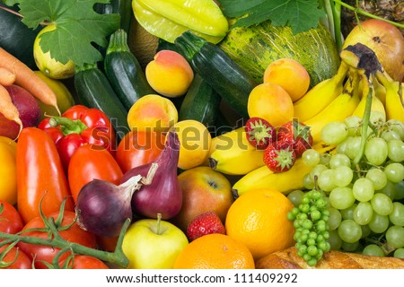 Fruits and vegetables like tomatoes, zucchini, melons, bananas and grapes arranged in a group, natural still life for healthy food - Shutterstock ID 111409292