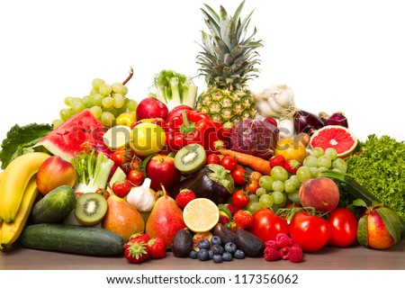 Fruits and vegetables like tomatoes, zucchini, melons, bananas and grapes arranged in a group, natural still life for healthy food