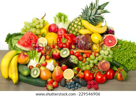 Fruits and vegetables like tomatoes, zucchini, melons, bananas and grapes arranged in a group, natural still life for healthy food  #229546906