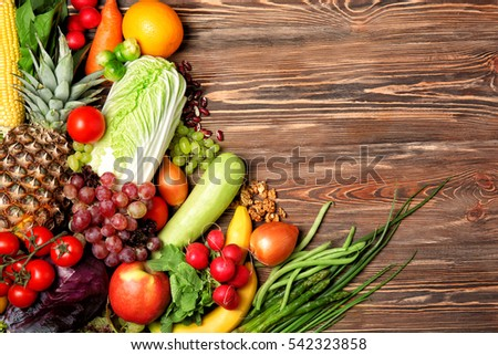Fruits and vegetables on wooden background #542323858