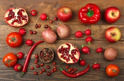 fruits and vegetables red flower scattered on brown wooden background