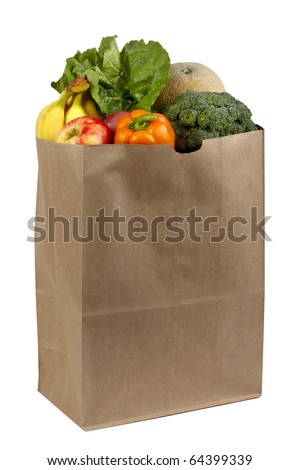 Fruits and vegetables shot in brown paper grocery bag, silhouetted on white background