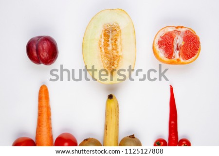 Fruits and vegetables symbolizing the male penis and female vagina. Sex concept