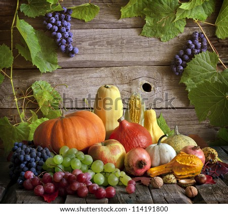 Fruits and vegetables with pumpkins in autumn still life