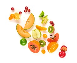 Fruits healthy food summer color layout. Papaya, orange, kiwi, melon isolated on white. Detox fruity health vitamin diet creative concept. Colorful fresh raw fruit tropical background, top view.