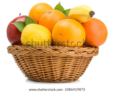 Fruits in basket isolated on white.