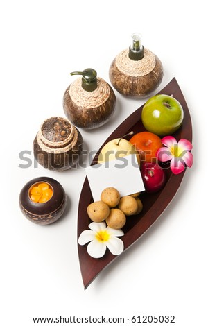 Fruits in the wooden leaf tray with small note - stock photo