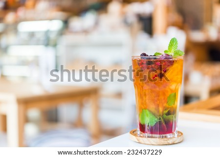 Fruits juice cocktail mixed with mint , lime , blueberry , berry
